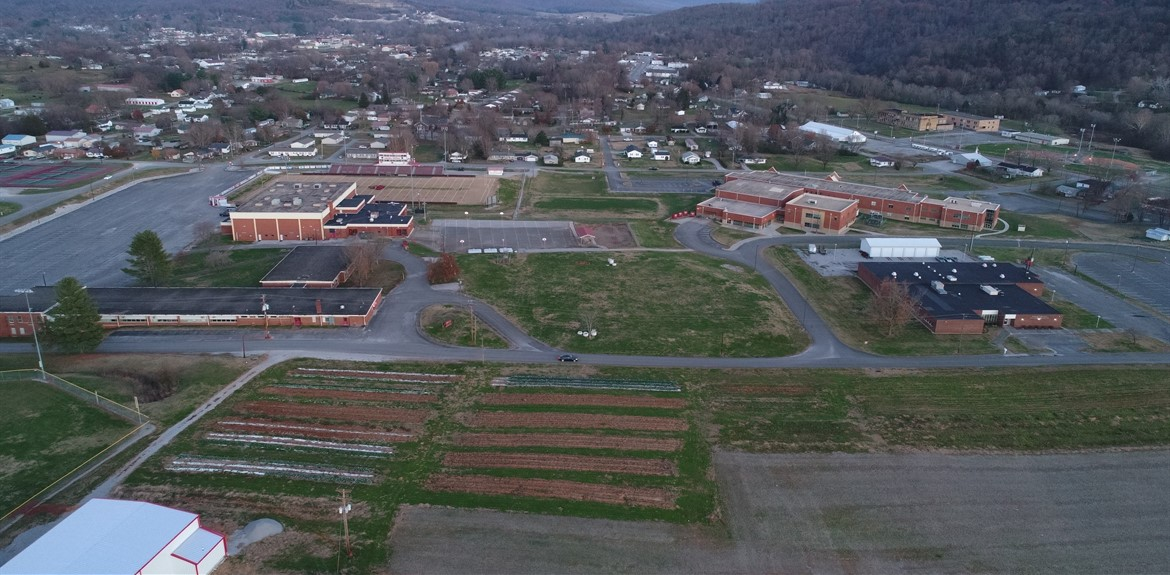 An aerial shot of Wayne County School District's Campus including the Football Field, WCMS, and the school garden.