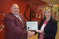 Wayne County Director of Pupil Personnel Stewart York presented Wayne County Middle School Principal Melissa Gossage with a certificate as a regional winner