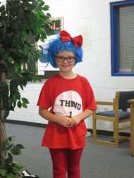 Girl dresses up as Thing 1