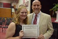 Alex Piercy and Justin Alley with her certificate from the Hagan Foundation