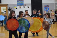 Second graders portray the Solar System