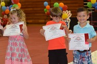 Students appreciate their certificates at Preschool Awards