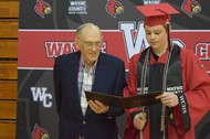 Austin Bell showed his grandfather, former WCHS Principal George Horton is diploma