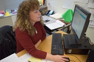 Sixth Grade Social Studies Teacher Malissa Atkinson works on an NTI assignment