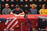 Elliott Cross accompanied by his family signs to become an archer at University of Cumberlands