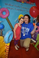 Walker Early Learning Center Preschool Teacher Whitney Burks and daughter Daisey enjoying the festivities, while preparing for kindergarten next year