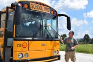 Mike Cooksey cleans a bus