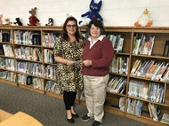 "'tis the Season Gift Shop"" Representative Katherine Kidd presented Walker Early Learning Principal Angela Ballinger with a check for the Imagination Library"