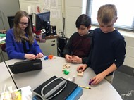 Jolene Spears, Elijah Bolen, and David Terry work on their puzzle design