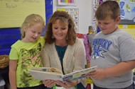 1st graders Daria Harvey and Brayden Crabtree with teacher Jessica Thrasher