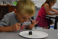 First Grader Levi Vaughn examines his rock