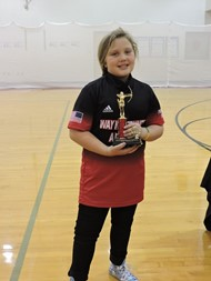 Lilly Owens at a previous tournament where she received a 4th place trophy