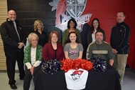 Lindsey smiles with her family, former and future coaches, and school administrators
