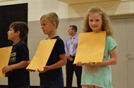 Savanna Bates stands with her classmates after receiving her awards