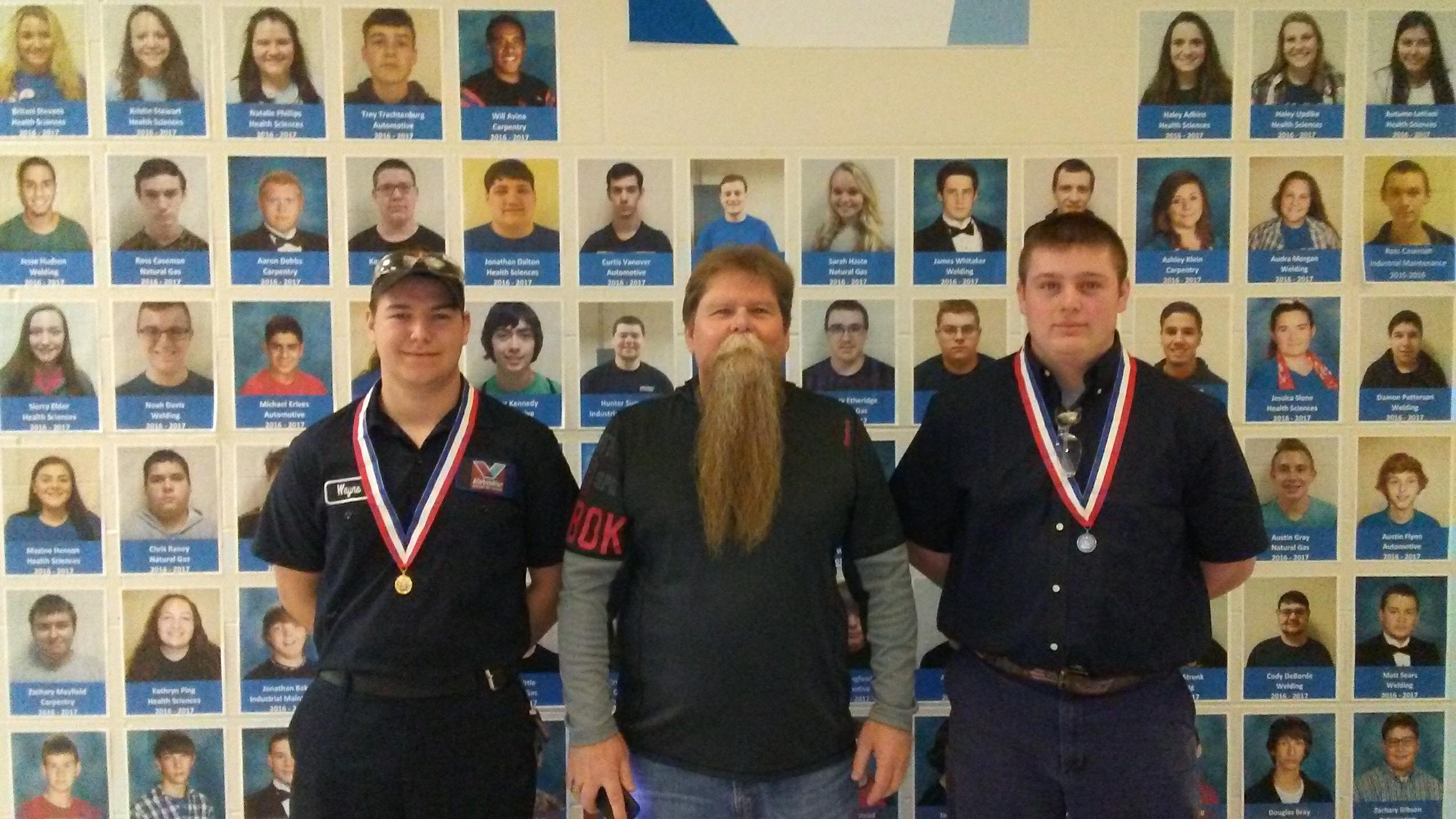 (l-r): Wayne Tucker, Marke Burke, and Arin Pittman; the two students competed in the Automotive Service Technology