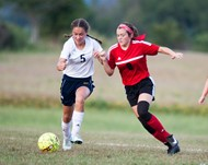 #8 Lady Card Forward Junior Gracie Chaplin fends off #5 Lady Panther Midfielder Emily Grubbs