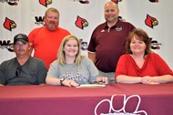 Breanna with her family and coaches