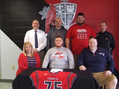 Barrett with his parents and school administrators