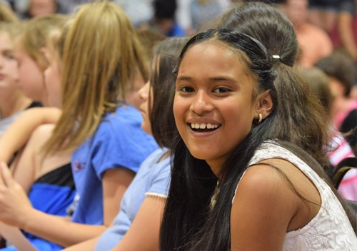 Allison Perez smiles during the fourth grade awards ceremony