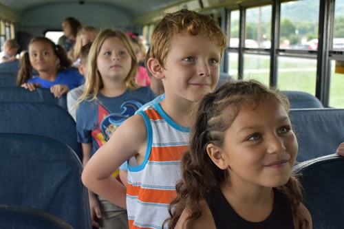 Bell Elementary first graders on bus during drill