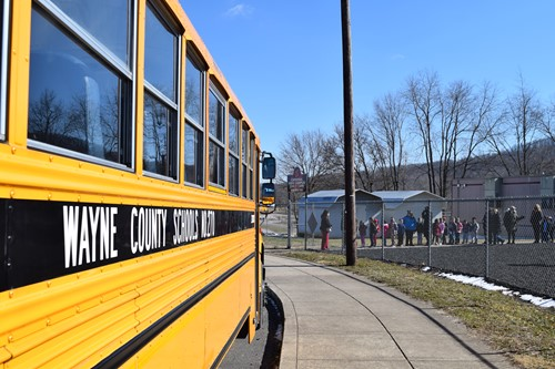 Buses pull up to school for evacuation drill