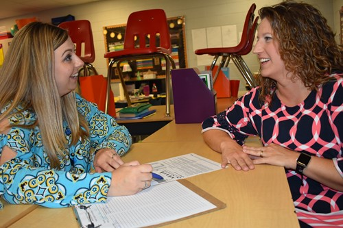 Cydi Neal and Jamie Jones share a laugh at parent teacher conference