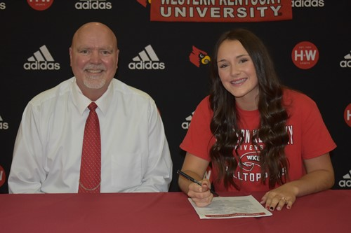 Coach McKinley and Macey Blevins at local in-house signing