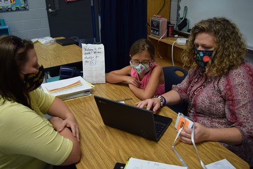 Teacher Katina Shearer works with a family