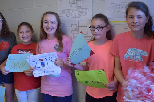Middle School students cheered on the upcoming graduates