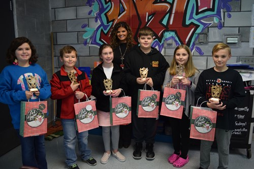 Winning Artists received gift bags and plaques for their work on the District Christmas card