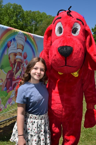 Monticello Elementary student Emily Gregory enjoyed hanging out with Clifford the Dog
