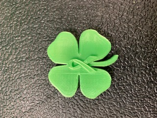 green clover leaf pin produced by the students