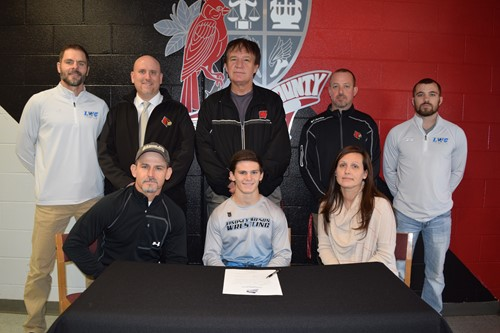 Cagen with his parents and coaches
