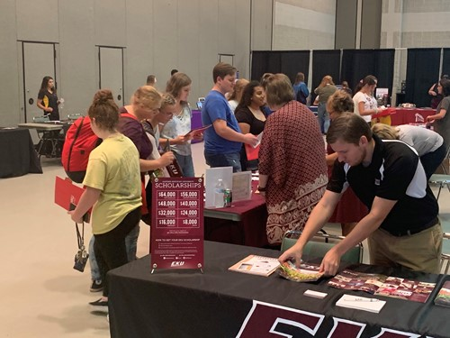 students visit college booths