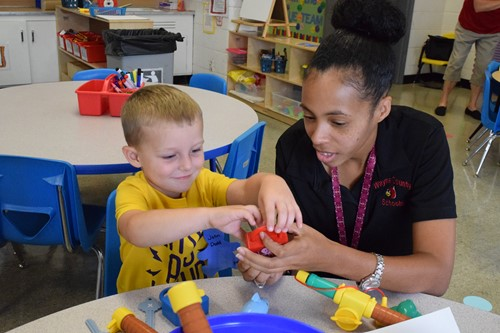 Preschool Wrap-Around Certified Teacher Andrea Williams with student John Dodd