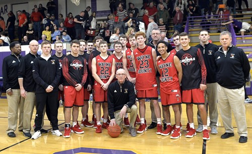 Wayne County Coach Rodney Woods won his 900th career game on Tuesday, February 8 at Somerset High School. The win also marked the 20th of the season for this year's team. The team and coaching staff celebrated with Woods for the following the win