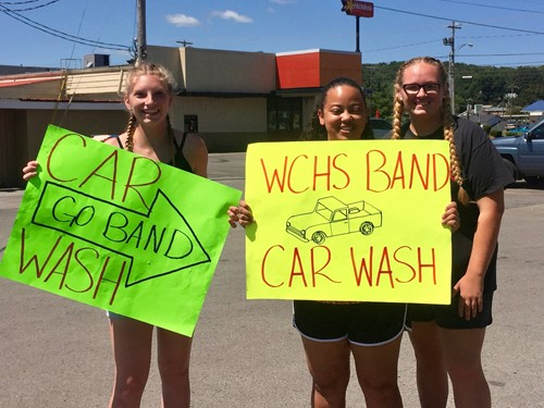 Band Students And Parents Worked At A Back To School Car Wash