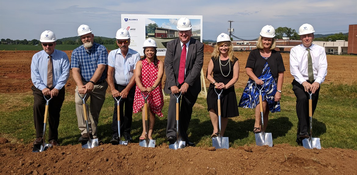 Members of the Board of Education break ground for the new ATC building