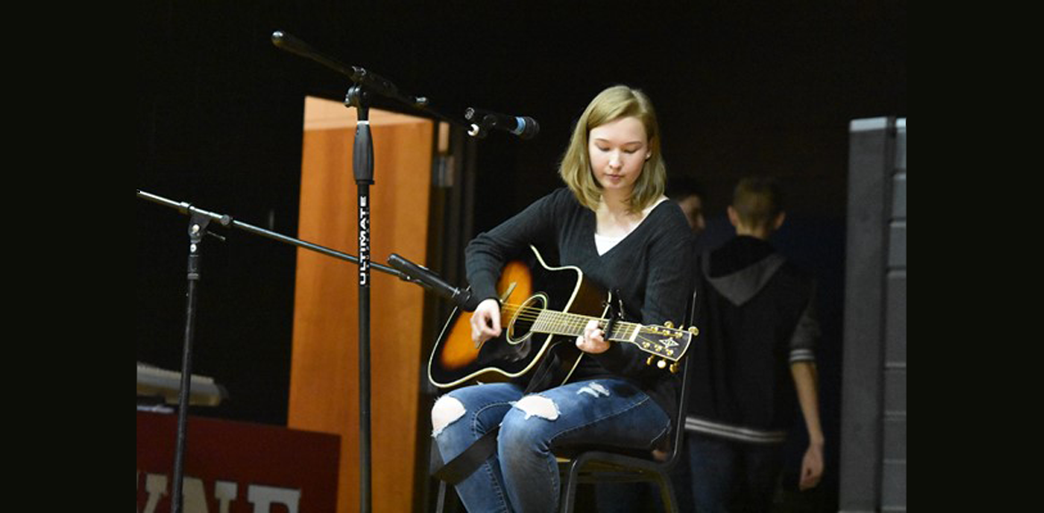 Abby Smith performing on her guitar during the 2018-19 WCHS Talent Show