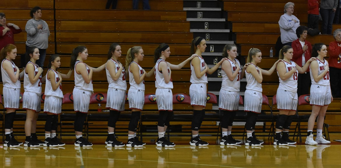 Lady Cards stand in camaraderie while they said the Pledge of Allegiance
