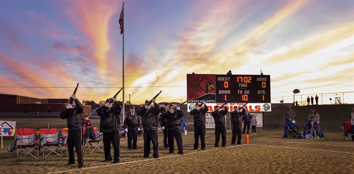 DAV performs a 21 gun salute honoring veterans at the football game