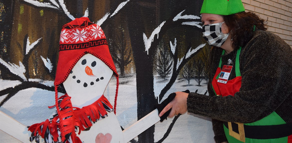 Counselor Jill Frogge shakes hands with Frosty at Drive-Thru special event