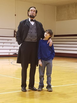 Abe LIncoln and a student at Monticello Elementary
