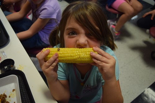 Bella Smith samples the corn