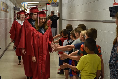 students receiving high fives