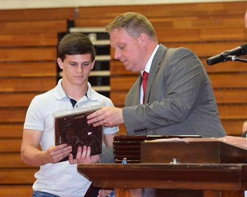 Stephen Thompson presented former WCHS student Cagan Wallace with an award on senior awards night