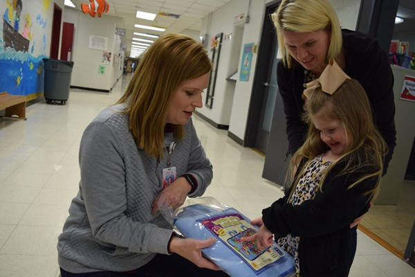 Family Resource Center Director Jill Wright handed out book packets