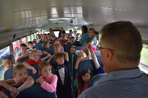 Driver Cooksey teaches students about bus safety