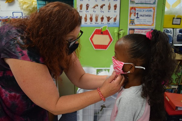 Principal Angela Ballinger adjusted a kindergarten students' mask