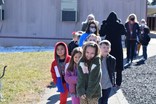Children excited to be together and participate in evacuation drill